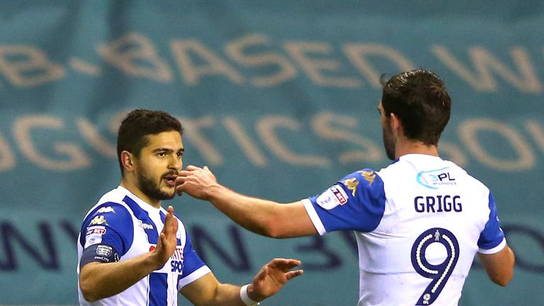Sam Morsy celebrates his goal with Will Grigg