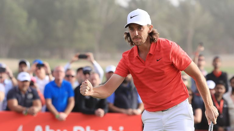 Tommy Fleetwood celebrates after birdieing the final hole