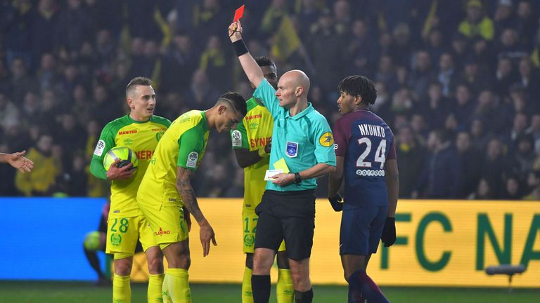Nantes' Brazilian defender Diego Carlos (C) receives a red card
