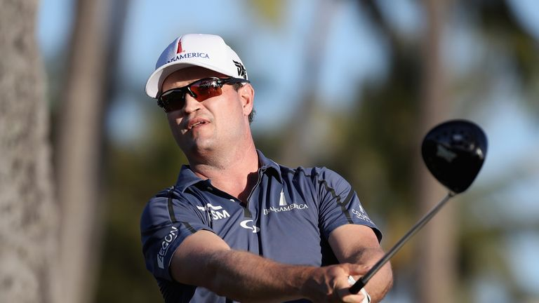Zach Johnson fired a flawless 63 to tie Chris Kirk at the top