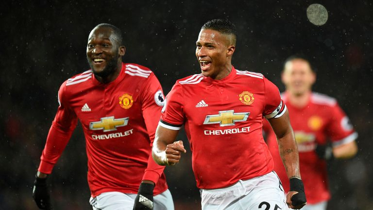 Manchester United's Ecuadorian midfielder Antonio Valencia (R) celebrates scoring the opening goal with Manchester United's Belgian striker Romelu Lukaku (