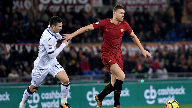 Atalanta's Italian defender Mattia Caldara  fights for the ball with Roma's forward Edin Dzeko during the Serie A football match