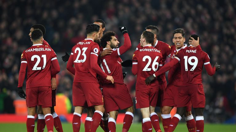 LIVERPOOL, ENGLAND - JANUARY 14: Mohamed Salah of Liverpool celebrates with team mates after scoring the fourth Liverpool goal during the Premier League ma