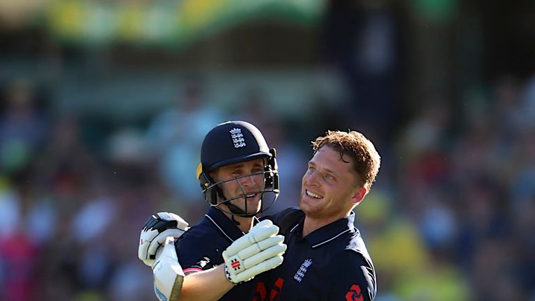 England batsman Chris Woakes (L) congratulates his teammate Jos Buttler after he reached his century during the third one-day international (ODI) cricket m