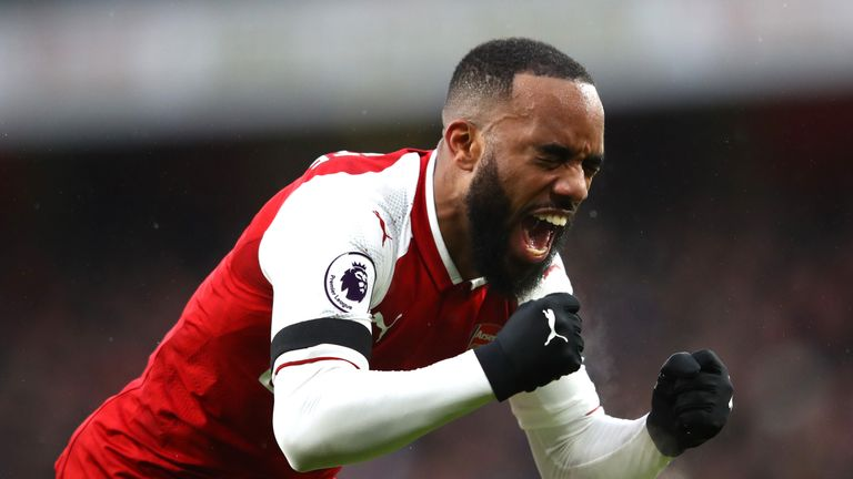 Alexandre Lacazette celebrates after making it 4-0
