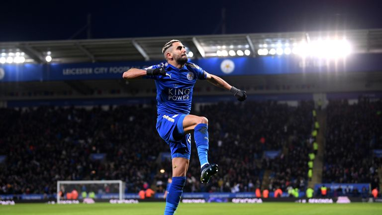 Riyad Mahrez of Leicester City celebrates after scoring his side's second goal against Huddersfield