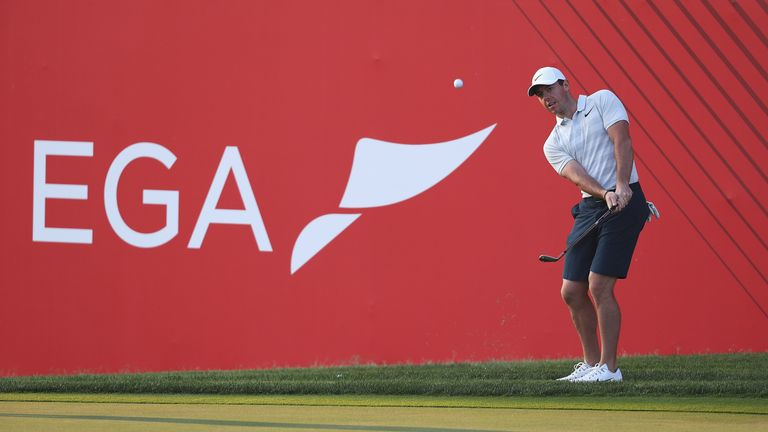 ABU DHABI, UNITED ARAB EMIRATES - JANUARY 15:  Rory McIlroy of Northern Ireland chips onto the 18th green during a practice round ahead of Abu Dhabi HSBC G