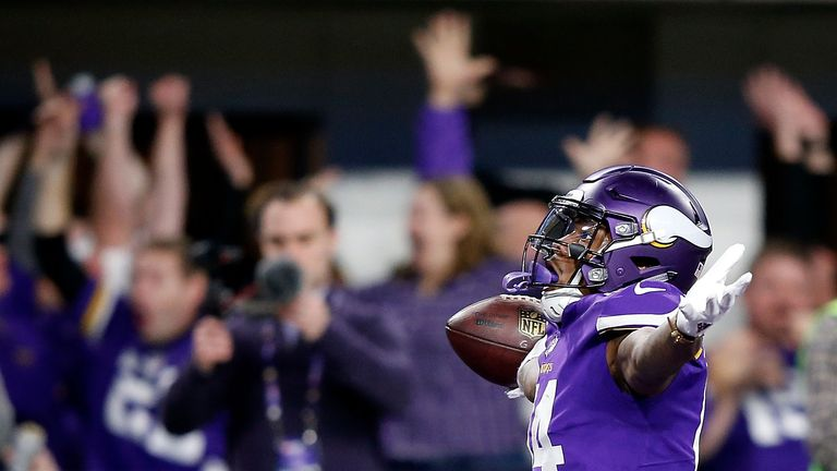 MINNEAPOLIS, MN - JANUARY 14:  Wide receiver Stefon Diggs #14 of the Minnesota Vikings celebrates as he runs into the endzone for the game-winning touchdow