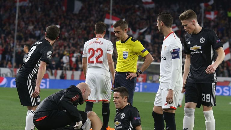 Manchester United midfielder Ander Herrera receives treatment on the pitch against Sevilla