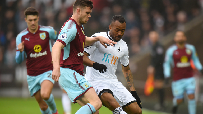 Jordan Ayew challenges for the ball