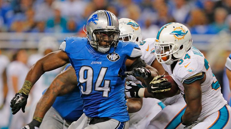 Lions retain defensive end Ansah by using franchise tage