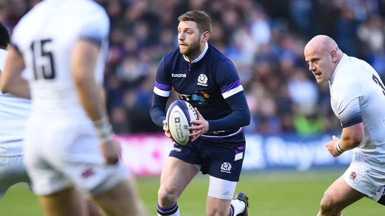Scotland's fly-half Finn Russell makes a break against England