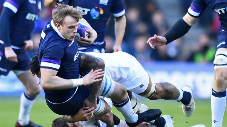 Scotland's lock Jonny Gray is tackled