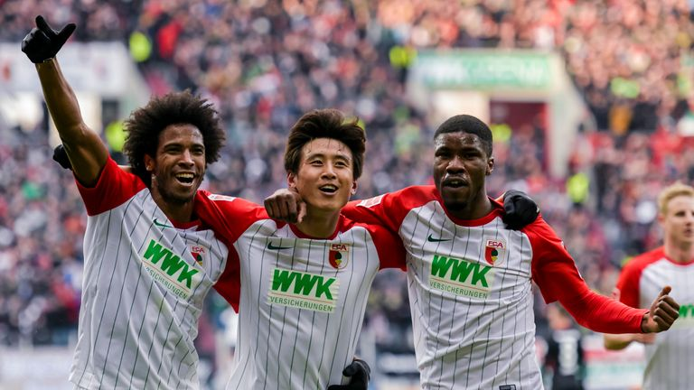 Kevin Danso (right) is popular with his Augsburg team-mates