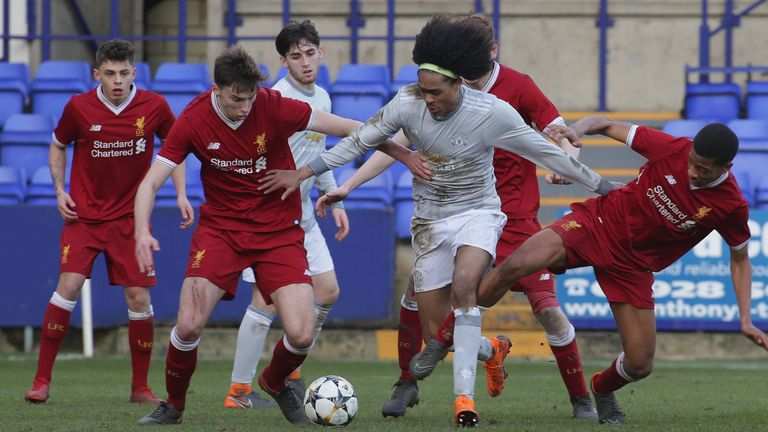 Man Utd midfielder Tahith Chong surrounded by Liverpool players