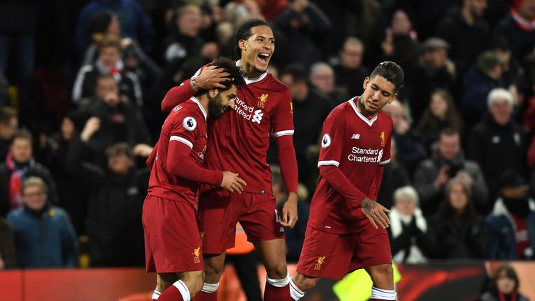 Mohamed Salah is mobbed by Virgil van Dijk after his sublime second strike
