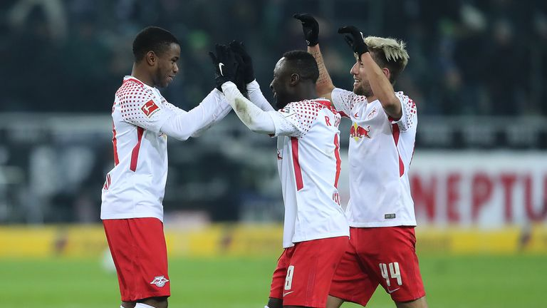 Ademola Lookman (left) celebrates his late winner for Leipzig