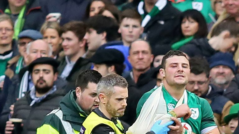 Ireland's centre Robbie Henshaw is helped from the field against Italy