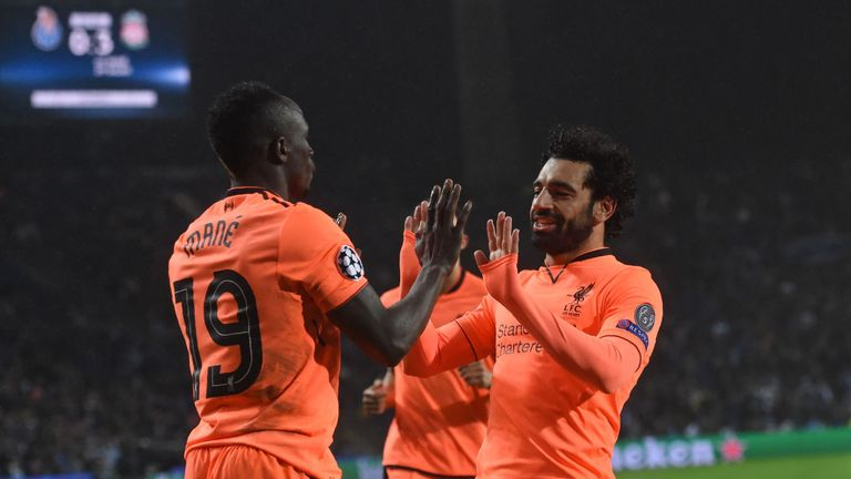 Mane celebrates with Mohamed Salah after scoring their third goal