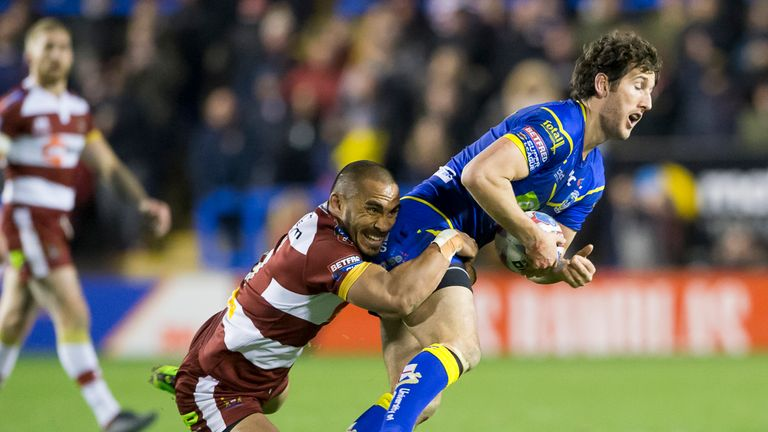 Warrington's Stefan Ratchford is tackled by Wigan's Thomas Leuluai