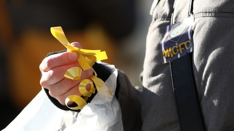 Yellow ribbons were handed out before the Carabao Cup Final between Arsenal and Manchester City