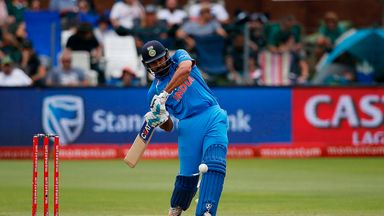 India batsman Rohit Sharma hits a four on a ball delivered by South Africa bowler Kagiso Rabada during the fifth One Day International cricket match betwee