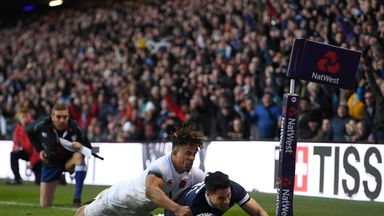 EDINBURGH, SCOTLAND - FEBRUARY 24: Sean Maitland of Scotland scores a try under pressure from Athony Watson of England during the NatWest Six Nations match