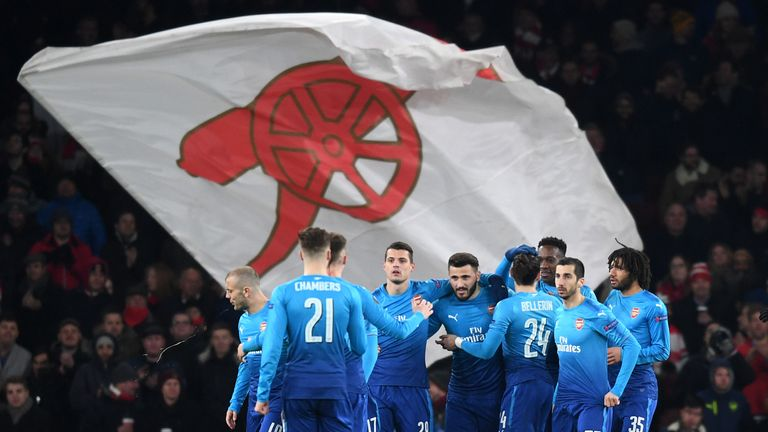 LONDON, ENGLAND - FEBRUARY 22:  Sead Kolasinac of Arsenal celebrates scoring the first Arsenal goal with team mates during UEFA Europa League Round of 32 m