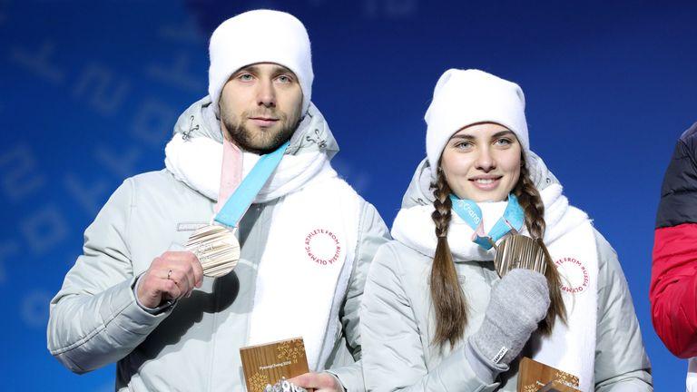 PYEONGCHANG-GUN, SOUTH KOREA - FEBRUARY 14:  Bronze medalists Aleksandr Krushelnitckii and Anastasia Bryzgalova of Olympic Athletes from Russia pose during
