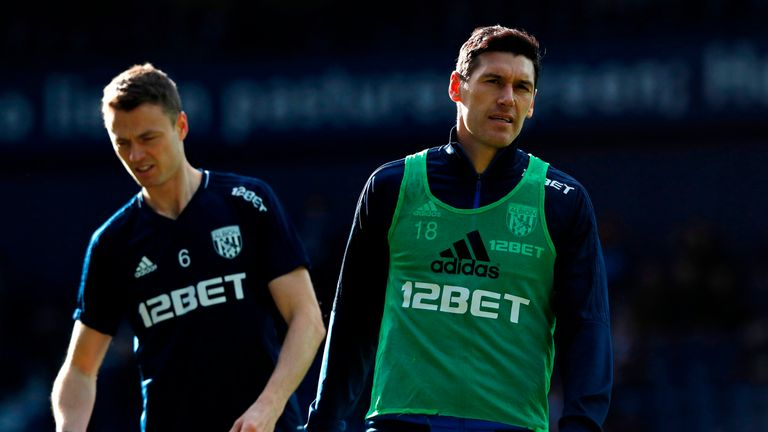 West Brom's Gareth Barry (right) and Jonny Evans