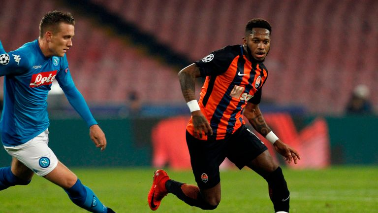 Napoli's midfielder from Poland Piotr Zielinski (L) vies with Shakhtar Donetsk's Brazilian midfielder Fred during the UEFA Champions League Group F footbal