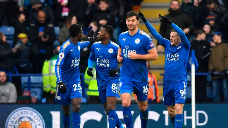 Leicester City's English striker Jamie Vardy (R) celebrates scoring the opening goal during the English Premier League football match between Leicester Cit