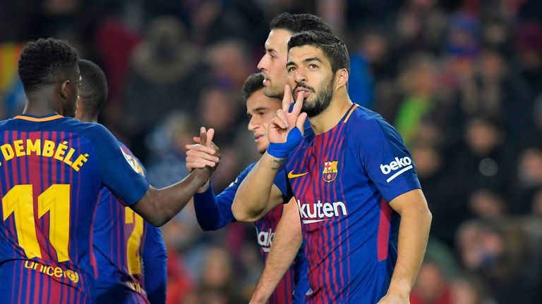 Barcelona's Uruguayan forward Luis Suarez (R) celebrates after scoring during the Spanish league football match between FC Barcelona and Girona FC at the C