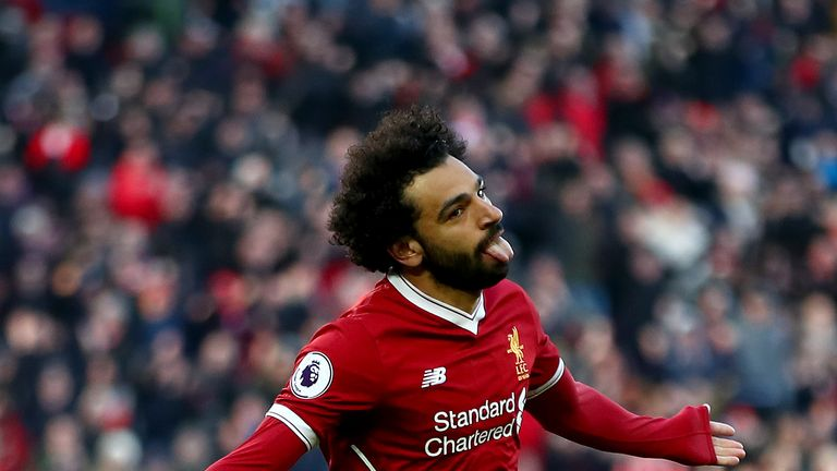 LIVERPOOL, ENGLAND - FEBRUARY 24:  Mohamed Salah of Liverpool celebrates scoring his side's second goal during the Premier League match between Liverpool a
