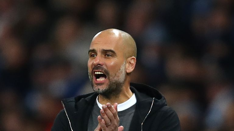 MANCHESTER, ENGLAND - FEBRUARY 10:  Josep Guardiola, Manager of Manchester City gives his team instructions during the Premier League match between Manches