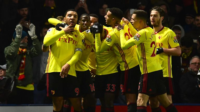 Watford's Troy Deeney celebrates scoring his side's first goal with teammates