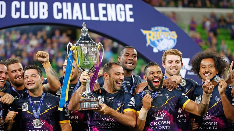 Cameron Smith and Melbourne Storm teammates celebrate with the World Club Challenge Cup after defeating Leeds Rhinos 38-4