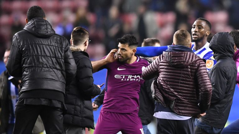 WIGAN, ENGLAND - FEBRUARY 19:  Sergio Aguero of Manchester City is surrounded by fans as he attempts to leave the pitch after the Emirates FA Cup Fifth Rou