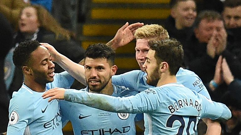Sergio Aguero celebrates with team-mates after making it 3-1