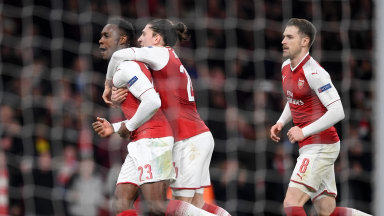 Danny Welbeck scored twice to send Arsenal into the Europa League quarter-finals