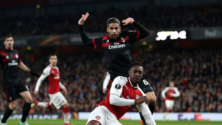 Welbeck went down under the challenge of AC Milan defender Ricardo Rodriguez