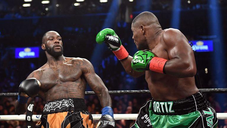 Luis Ortiz (R) was beaten by Deontay Wilder in March
