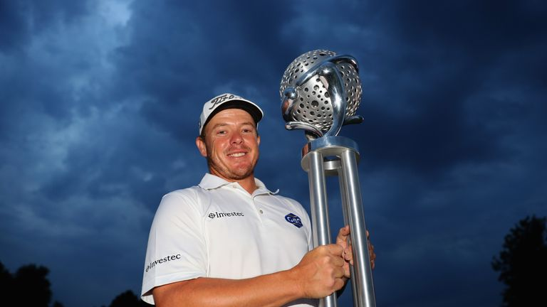George Coetzee proudly displays the trophy after winning the Tshwane Open for a second time