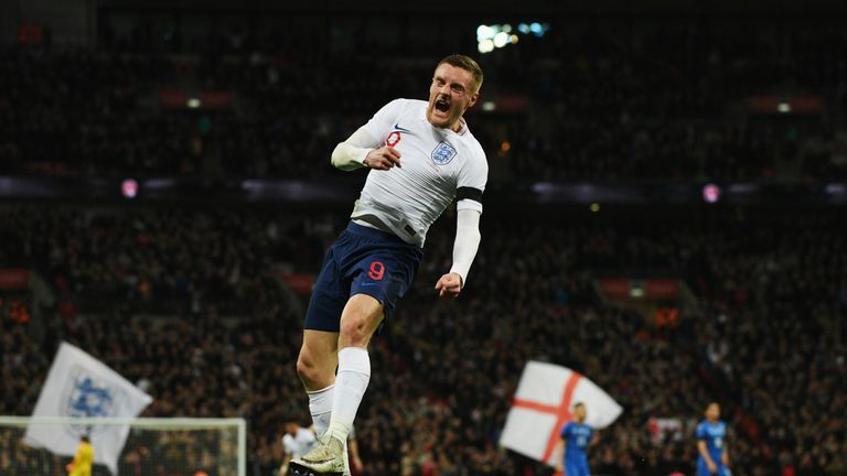 Jamie Vardy celebrates after scoring the opening goal for England