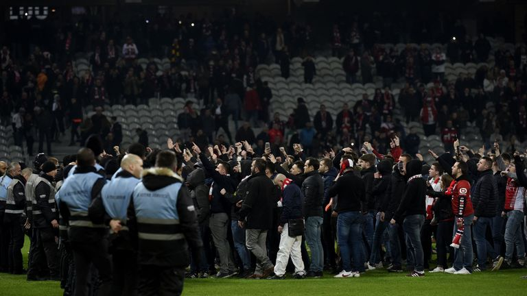 Players were forced to flee down the tunnel after hundreds of fans invaded the pitch