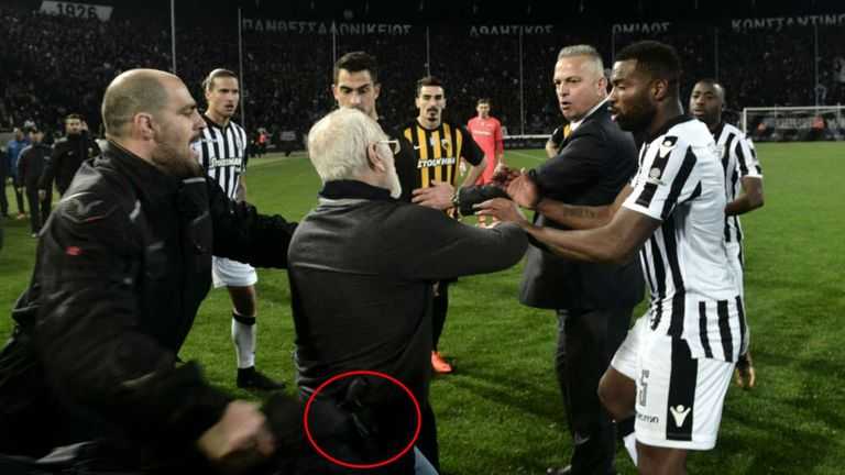PAOK president Ivan Savvidis ran onto the pitch carrying a handgun in his waistband