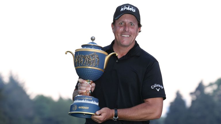 Phil Mickelson proudly displays the Gene Sarazen trophy after winning the WGC-Mexico Championship