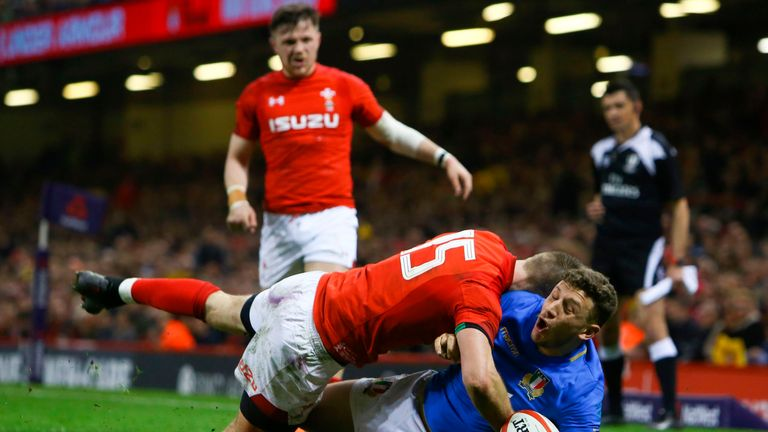 Liam Williams was yellow-carded for this tackle on Italy full-back Matteo Minozzi