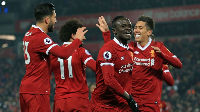 Sadio Mane celebrates his goal with teammates during the Premier League match between Liverpool and Newcastle United at Anfield