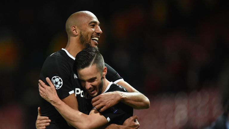 N'Zonzi celebrates with Pablo Sarabia after Sevilla's win at Old Trafford